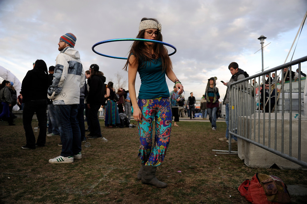 . DENVER, CO - APRIL 4: Laura Marsh, 20, of Lakewood, hula hoops as The Floozies perform during the Snowball Music Festival at Sports Authority Field at Mile High Stadium on April 4, 2014 in Denver, Colorado. The Snowball Music Festival is celebrating its first year in Denver after spending the previous three years as a mountain based festival. (Photo by Seth McConnell/The Denver Post)