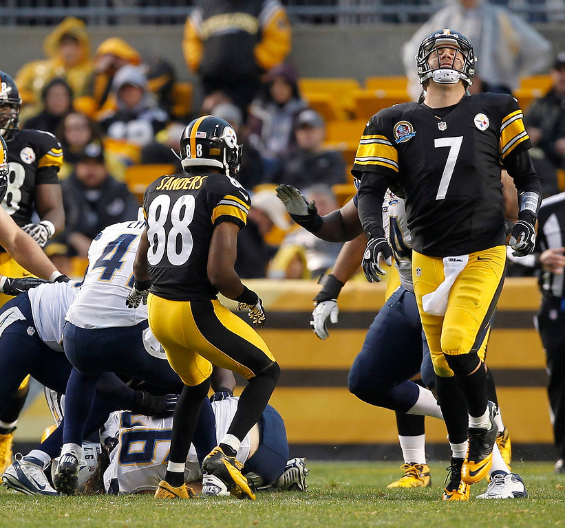 . Pittsburgh Steelers quarterback Ben Roethlisberger (7) reacts after his pass was intercepted by San Diego Chargers Bront Bird in the fourth quarter of their NFL football game in Pittsburgh, Pennsylvania, December 9, 2012. REUTERS/Jason Cohn