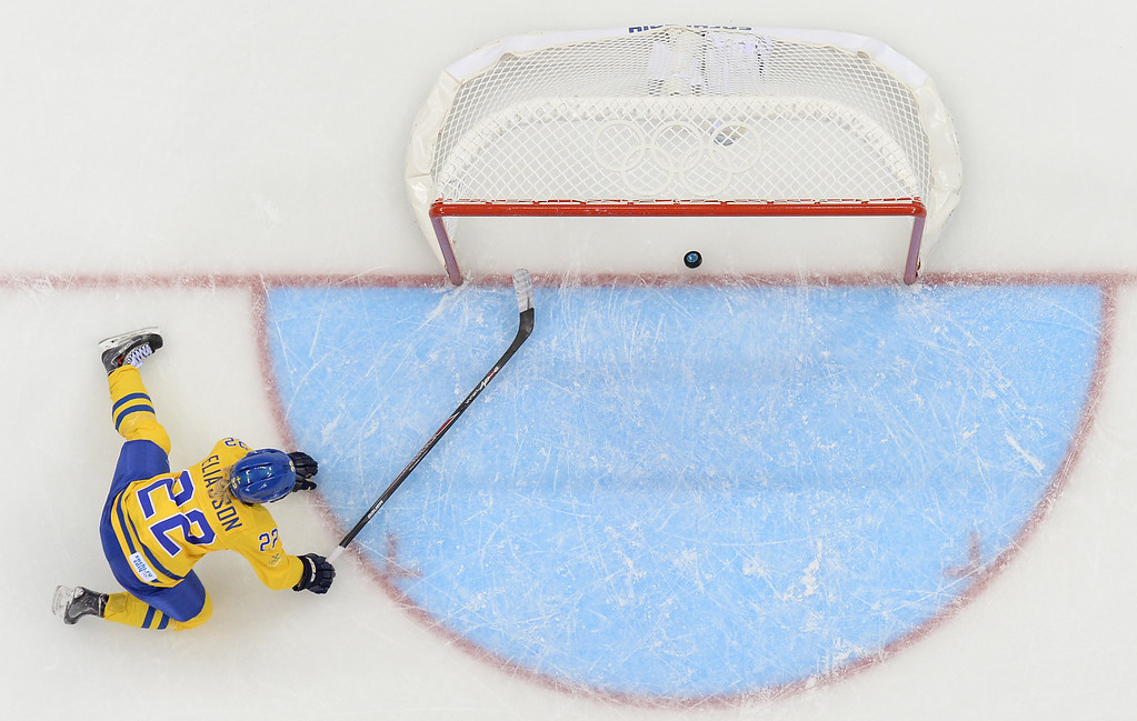 . Sweden\'s Emma Eliasson rushes to the goal but can\'t stop the puck to go in and Russia to score its third goal during the Women\'s Ice Hockey Group B match Sweden vs Russia at the Shayba Arena at the Sochi Winter Olympics on February 13, 2014 in Sochi.    ANDREJ ISAKOVIC/AFP/Getty Images