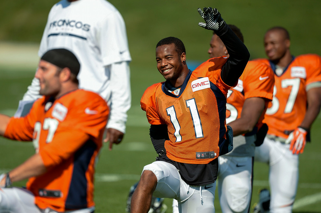 . Denver Broncos wide receiver Jordan Norwood (11) stretches on day five of the Denver Broncos 2014 training camp July 28, 2014 at Dove Valley. (Photo by John Leyba/The Denver Post)