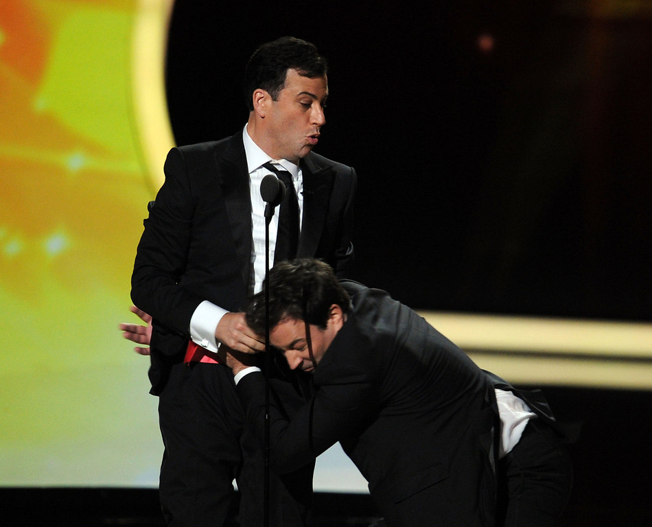 . TV show host\'s Jimmy Kimmel (L) and Jimmy Fallon speak onstage during the 63rd Annual Primetime Emmy Awards held at Nokia Theatre L.A. LIVE on September 18, 2011 in Los Angeles, California.  (Photo by Kevin Winter/Getty Images)