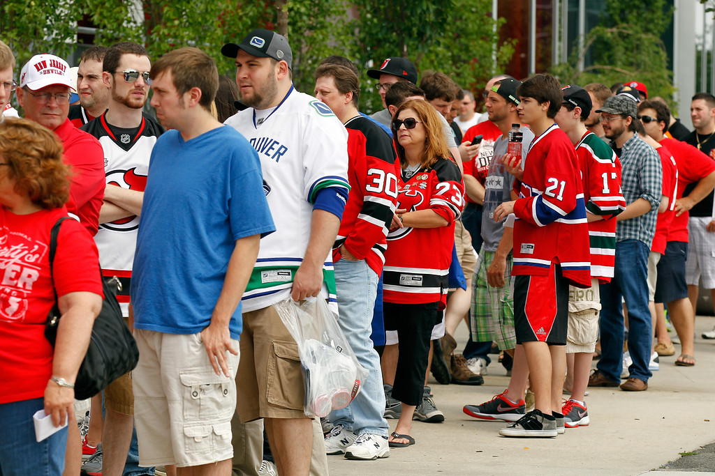 . Fans attend the 2013 NHL Draft Fan Fest and Memorabilia Show at the Prudential Center on June 30, 2013 in Newark, New Jersey.  (Photo by Mike Stobe/Getty Images)