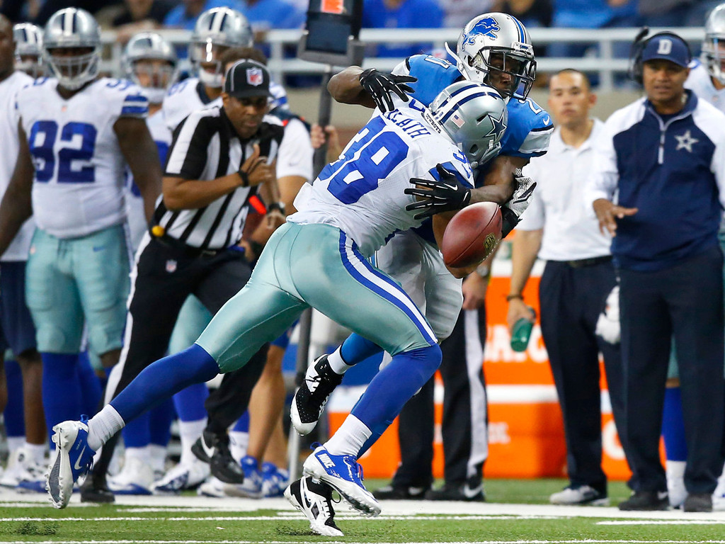 . Detroit Lions running back Reggie Bush (21) fumbles the ball as Dallas Cowboys defensive back Jeff Heath (38) makes the tackle in the third quarter of an NFL football game in Detroit, Sunday, Oct. 27, 2013. (AP Photo/Rick Osentoski)