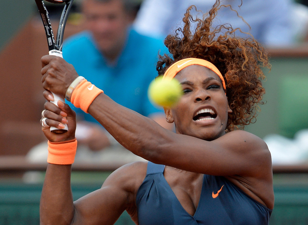 . USA\'s Serena Williams returns to Russia\'s Maria Sharapova during their French tennis Open final match at the Roland Garros stadium in Paris on June 8, 2013. AFP PHOTO / MIGUEL MEDINA/AFP/Getty Images