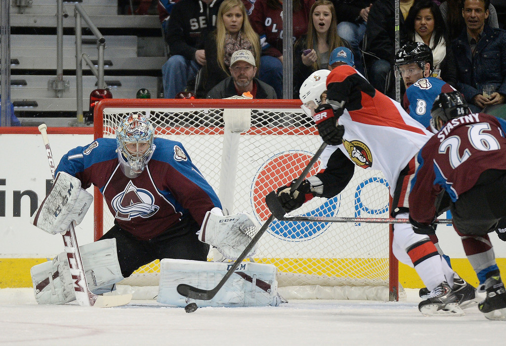 . Colorado Avalanche goalie Semyon Varlamov (1) looks on as Ottawa Senators center Kyle Turris (7) tries to get a shot off during the first period January 8, 2014 at Pepsi Center. (Photo by John Leyba/The Denver Post)