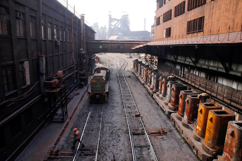 . A locomotive engine travels along the rail tracks inside the Zaporizhstal steel plant, owned and operated by Metinvest BV, at their site in Zaporizhzhya, Ukraine, on Monday, Oct. 14, 2013. Metinvest BV, Ukraine\'s largest steelmaker, last year acquired 49.9% in steelmaker Zaporizhstal a manufacturer of semi-finished steel products, including hot and cold-rolled plates and coils. Photographer: Vincent Mundy/Bloomberg
