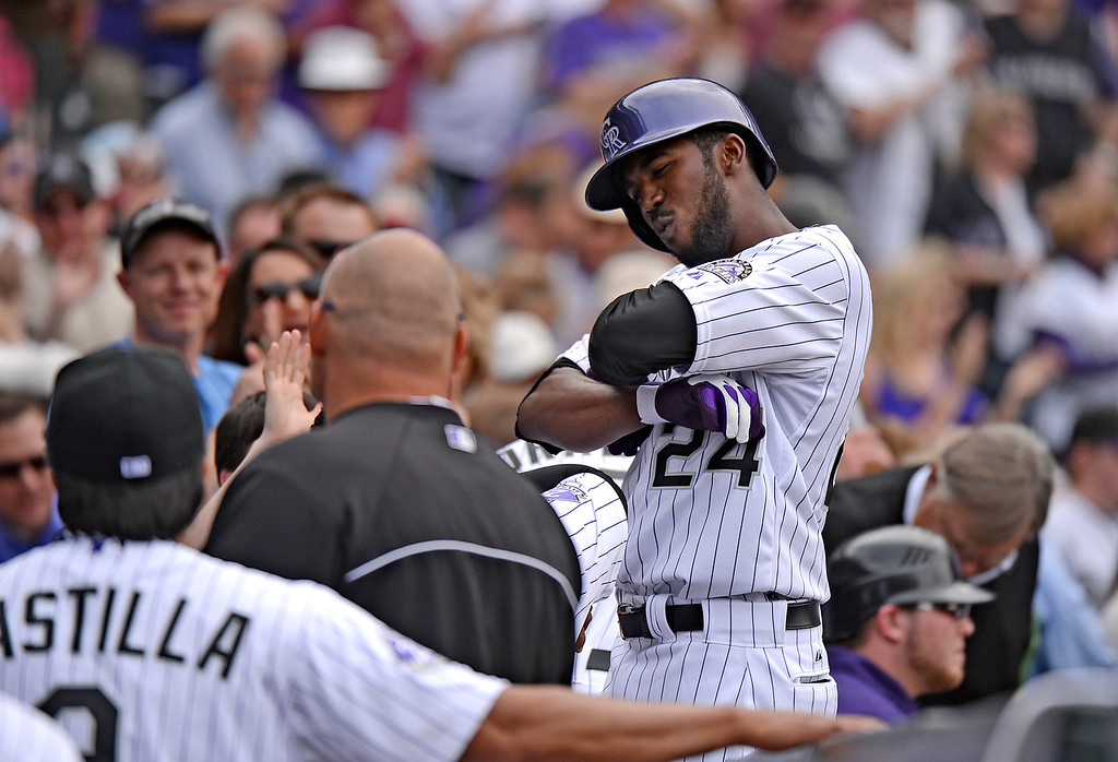 . Dexter Fowler (24) of the Colorado Rockies celebrates when he returns to the dugout after hitting a home run to right in the fifth inning. (Photo by Hyoung Chang/The Denver Post)