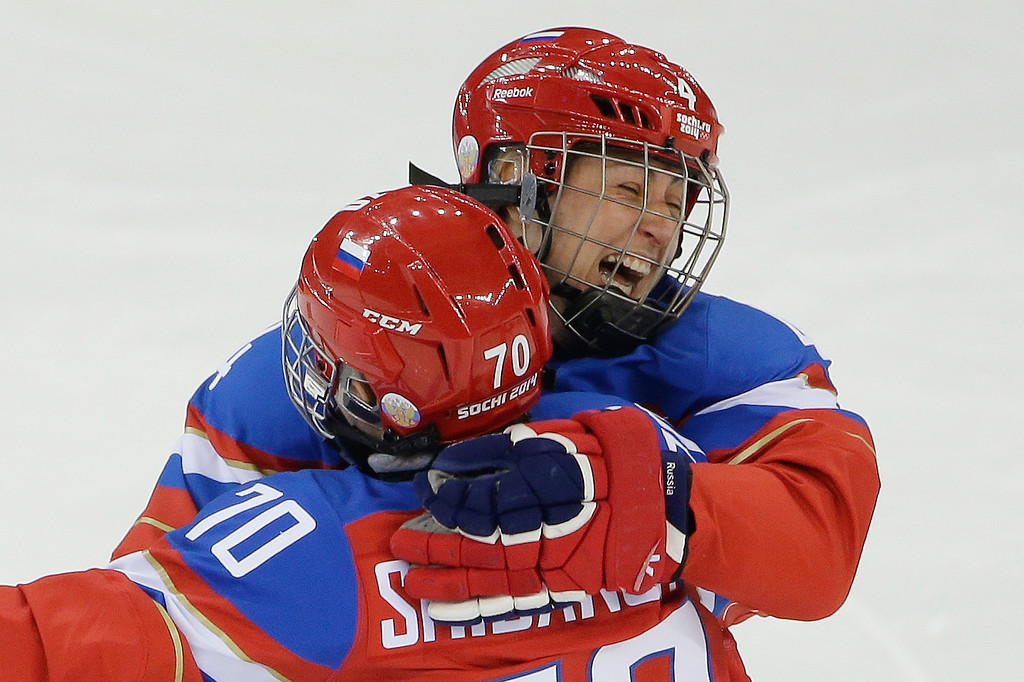 . Alyona Khomich of Russia (4) celebrates her goal against Sweden with teammate Anna Shibanova during the 2014 Winter Olympics women\'s ice hockey game at Shayba Arena, Thursday, Feb. 13, 2014, in Sochi, Russia. (AP Photo/Matt Slocum)