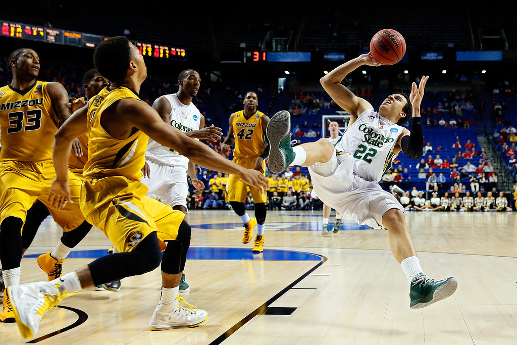. LEXINGTON, KY - MARCH 21:  Dorian Green #22 of the Colorado State Rams loses his balances after drawing contact against Missouri Tigers during the second round of the 2013 NCAA Men\'s Basketball Tournament at the Rupp Arena on March 21, 2013 in Lexington, Kentucky.  (Photo by Kevin C. Cox/Getty Images)