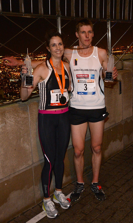 . Australia\'s Suzy Walsham (L) and Mark Bourne celebrate after winning the 36th annual Empire State Building run-up in New York, February 6, 2013. Some 600 competitors entered the race which consist of racing up 86 floors, 1,576 steps, and 1,050 feet from the lobby to the iconic 86th floor Observatory.  EMMANUEL DUNAND/AFP/Getty Images