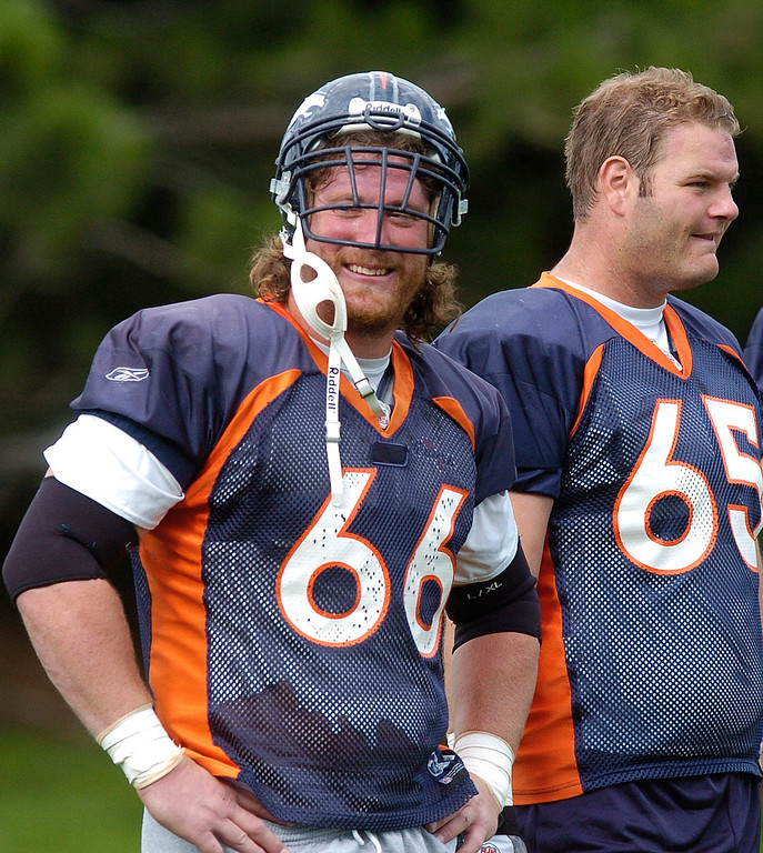 . Tom Nalen, left, smiles at Jake Plummer ,Wednesday, August, 3, 2005, during the morning section of Broncos camp at Dove Valley as he stands next to Cooper Carlisle. RJ Sangosti/ The Denver Post