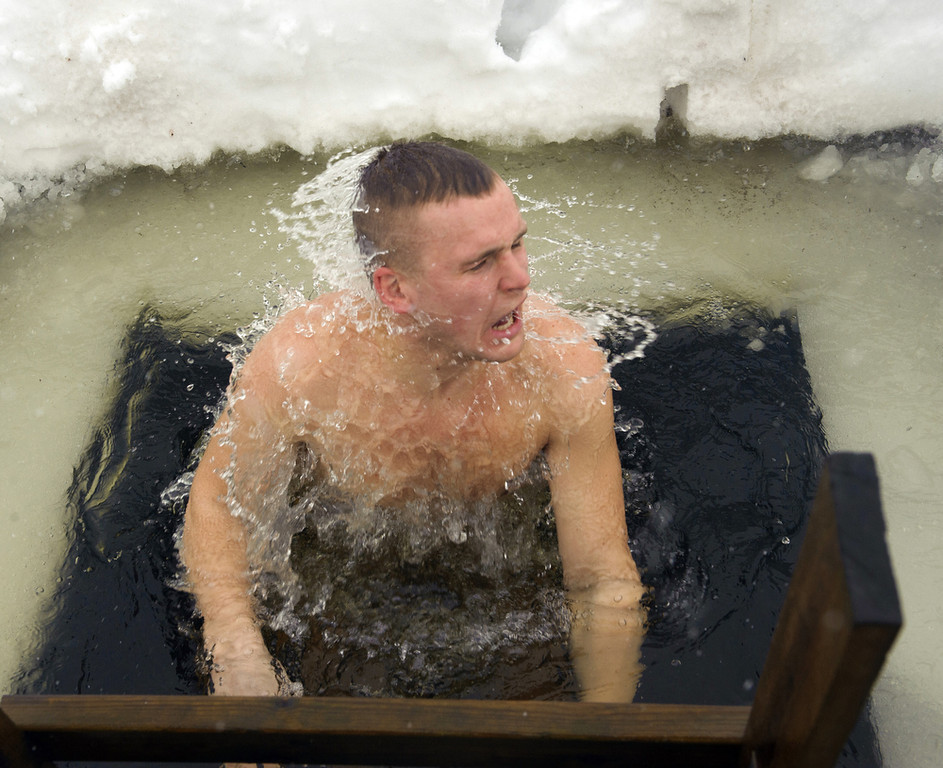 . A man bathes in icy water as he takes part in the European Sauna Marathon in Otepaeae, southern Estonia, on February 10, 2013. Around 600 participants in 150 teams compete in the event to find out which team takes the shortest time to use 22 saunas and to jump into nine ice holes.     AFP PHOTO / RAIGO PAJULA / ESTONIA OUTRAIGO PAJULA/AFP/Getty Images