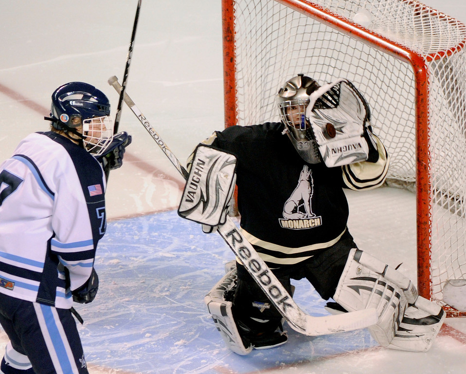 . DENVER, CO. - FEBRUARY 28: Coyotes goaltender Ian Oden tried to get his glove around a shot as Mustangs forward Greg Dyba (7) moved in during the second period. Ralston Valley exploded for three goals in the second period. Monarch High School matched up against Ralston Valley Friday night, March 1, 2013 in the championship game of the state hockey playoffs at Magness Arena in Denver. (Photo By Karl Gehring/The Denver Post)