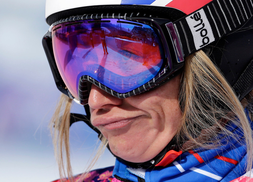 . France\'s Deborah Anthonioz reacts after her seeding run during women\'s snowboard cross competition at the Rosa Khutor Extreme Park, at the 2014 Winter Olympics, Sunday, Feb. 16, 2014, in Krasnaya Polyana, Russia. (AP Photo/Andy Wong)