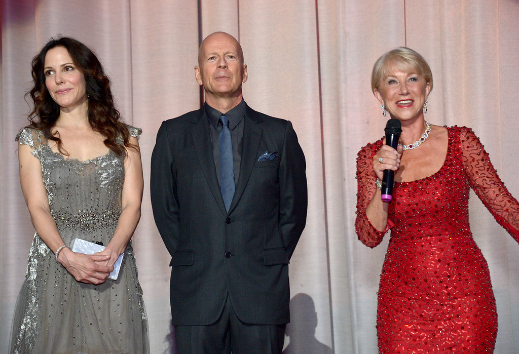 . Mary-Louise Parker, Bruce Willis and Dame Helen Mirren at the European Premiere of Red 2, on Monday July 22, 2013 in London. (Photo by Jon Furniss/Invision/AP Images)