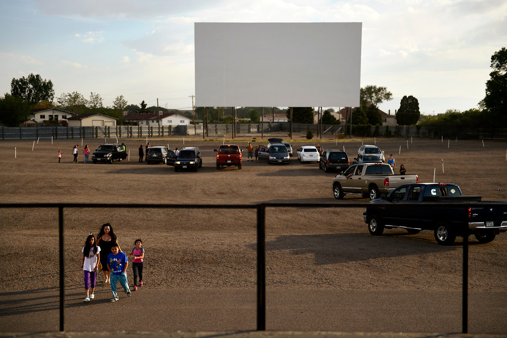 . PUEBLO, CO. - May 24: A family of early birds head to the snack bar at the Mesa Drive In owned by Chuck and Marianne James. The theater is in it\'s last season of running 35mm film movies, they will be switching over the 3 projectors at their tri-plex to Digital Cinema after this season. May 24, 2013 Pueblo, Colorado. (Photo By Joe Amon/The Denver Post)