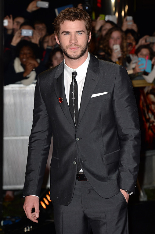 """. Liam Hemsworth attends the UK Premiere of \""""The Hunger Games: Catching Fire\"""" at Odeon Leicester Square on November 11, 2013 in London, England. (Photo by Zak Hussein/Getty Images)"""