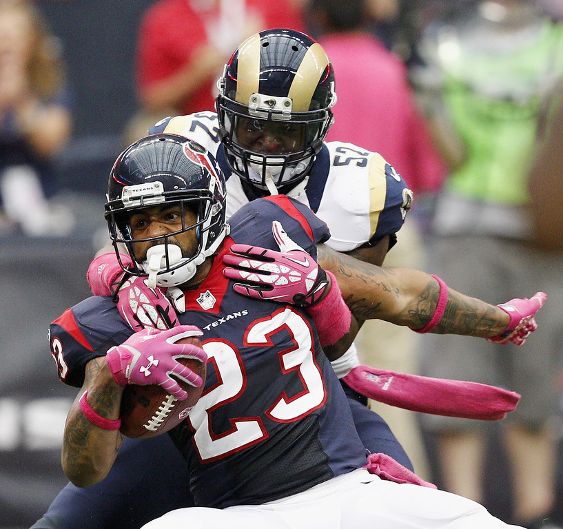 . Arian Foster #23 of the Houston Texans is tackled by Alec Ogletree #52 of the St. Louis Rams in the second quarter at Reliant Stadium on October 13, 2013 in Houston, Texas.  (Photo by Bob Levey/Getty Images)