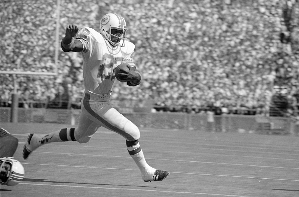 """. Miami Dolphins running back Eugene \""""Mercury\"""" Morris literally flies over the goal Sunday, Nov. 13, 1972 for a score against the New England Patriots, 52-0 to give coach Don Shula his 100th victory in ten years in the NFL. The game was played in Miami\'s orange Bowl. (AP Photo/Jim  Bourdier)"""
