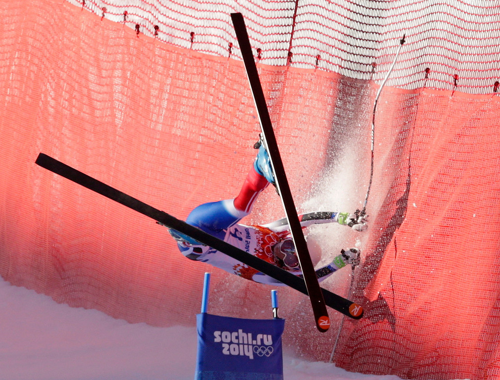 . France\'s Marie Marchand-Arvier crashes into safety netting during the women\'s downhill at the Sochi 2014 Winter Olympics, Wednesday, Feb. 12, 2014, in Krasnaya Polyana, Russia. (AP Photo/Charles Krupa)