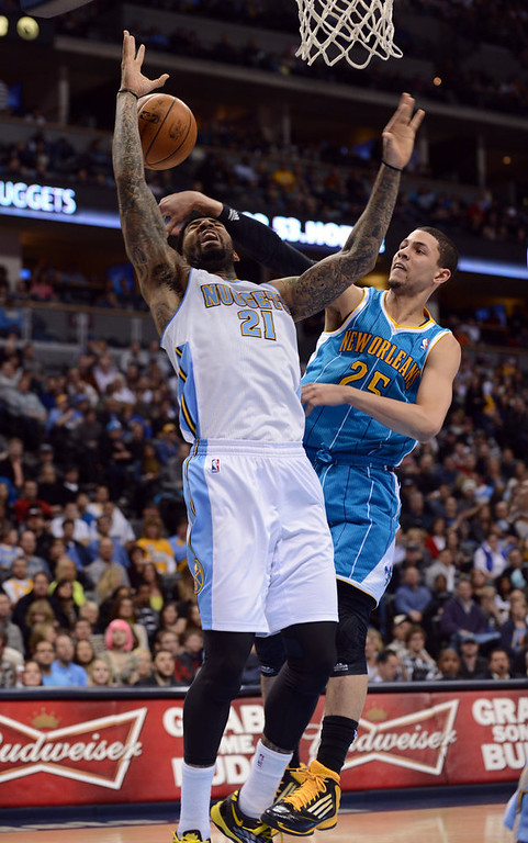 . DENVER, CO. - FEBRUARY 01: Wilson Chandler of Denver Nuggets #21 is fouled by Austin Rivers of New Orleans Hornets #25 in the 2nd half of the game on February 1, 2013 at the Pepsi Center in Denver, Colorado. Denver won 113-98. (Photo By Hyoung Chang/The Denver Post)
