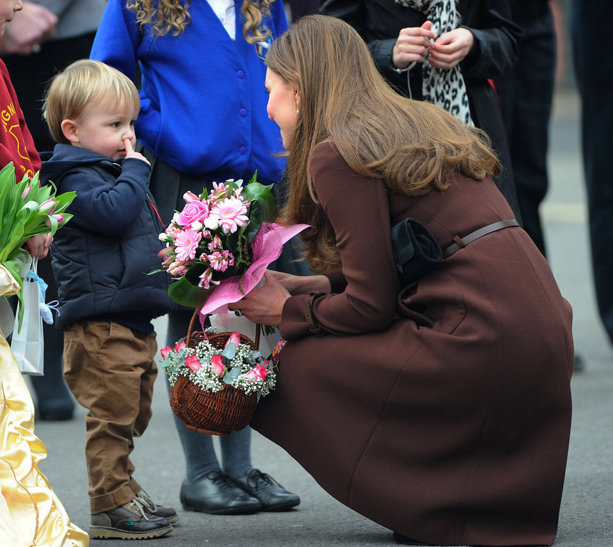 . Catherine, Duchess of Cambridge meets three year old Olllie Axel (crouching) as she visits Humberside Fire and Rescue Peaks Lane Fire Station on March 5, 2013 in Grimsby, England.  (Photo Bruce Adams  - WPA Pool/Getty Images)