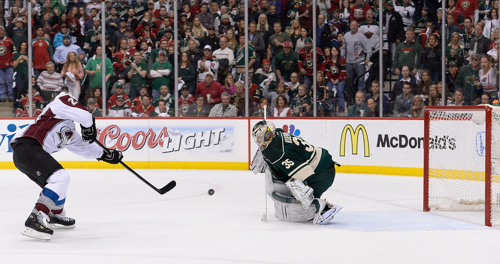 . Colorado Avalanche center Paul Stastny (26) takes a shot on Minnesota Wild goalie Darcy Kuemper (35) for a score on a short handed power play during the first period April 28, 2014 in Game 6 of the Stanley Cup Playoffs at Xcel Energy Center.  (Photo by John Leyba/The Denver Post)