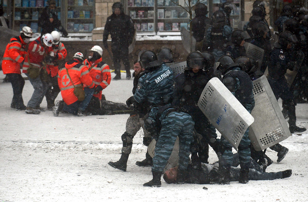 . Riot police arrest protestors in the centre of Kiev on January 22, 2014. Ukrainian police today stormed protesters\' barricades in Kiev as violent clashes erupted and activists said that one person had been shot dead by the security forces.  AFP PHOTO/ VASILY MAXIMOV/AFP/Getty Images