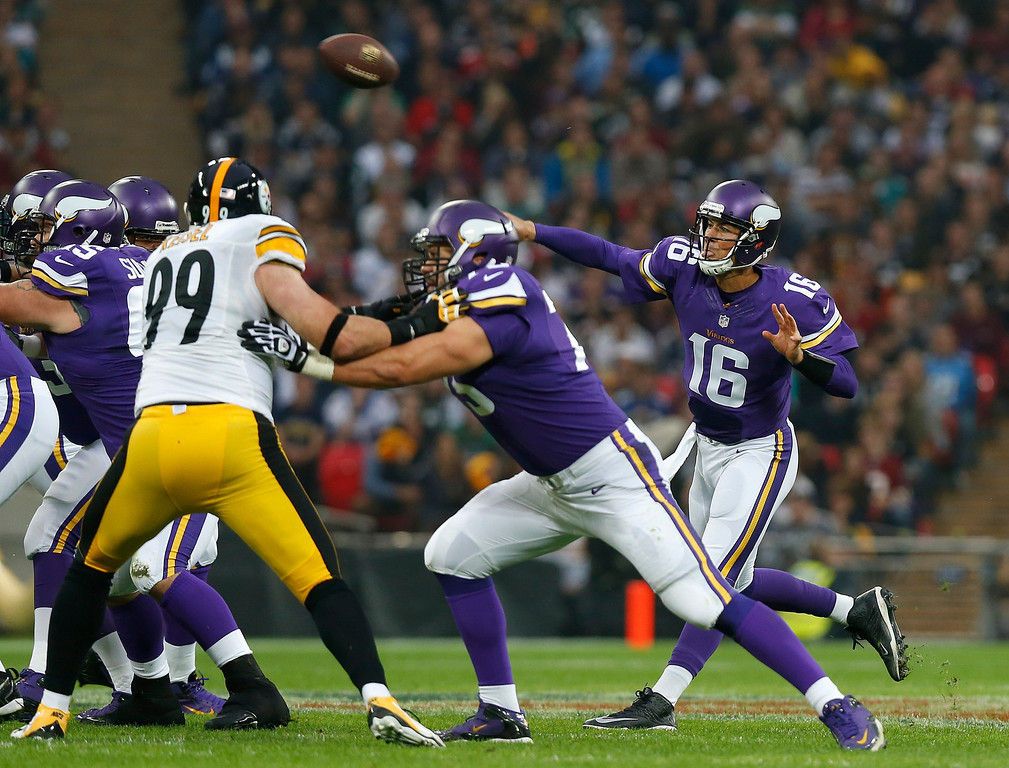 . Minnesota Vikings quarterback Matt Cassel , right, passes the ball during the NFL football game against Pittsburgh Steelers at Wembley Stadium, London , Sunday, Sept. 29, 2013.  (AP Photo/Sang Tan)
