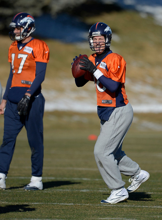 . Denver Broncos quarterback Peyton Manning (18) looks to throw a pass during practice January 2, 2014 at Dove Valley (Photo by John Leyba/The Denver Post)