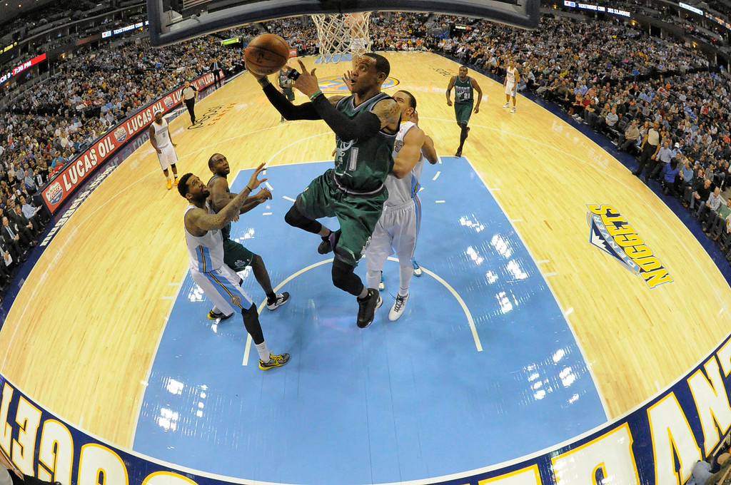 . DENVER, CO. - FEBRUARY 05: Monta Ellis (11) of the Milwaukee Bucks flies past JaVale McGee (34) of the Denver Nuggets for a reverse layup February 05, 2013 at Pepsi Center. The Denver Nuggets defeated the Milwaukee Bucks 112-104 in NBA action. (Photo By John Leyba/The Denver Post)