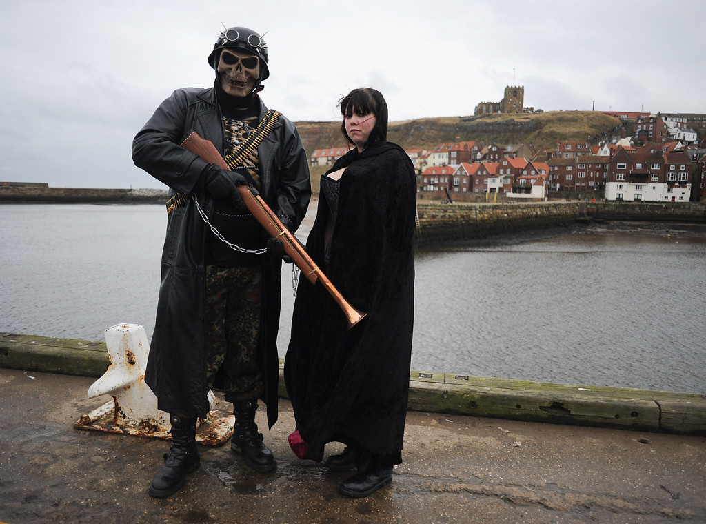 . WHITBY, ENGLAND - NOVEMBER 02: Mark Howard, 28, a caretaker and his partner Lilly Hammond, 24, a records library clerk, both from Manchester dress in Steampunk style as they take part in the Goth weekend on November 2, 2013 in Whitby, England. The Whitby Gothic Weekend that takes place in the Yorkshire seaside town twice yearly in Spring and Autumn started in 1994 and sees thousands of extravagantly dressed followers of Victoriana, Steampunk, Cybergoth and Romanticism visit to take part in celebrating Gothic culture.  (Photo by Ian Forsyth/Getty Images)