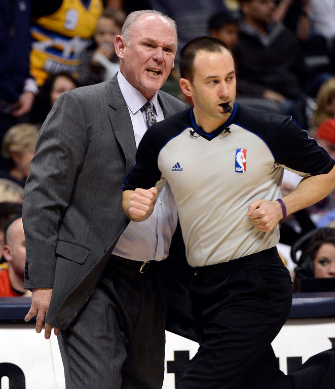 . Denver Nuggets head coach George Karl screams at NBA referee Kane Fitzgerald during the second quarter January 28, 2013 at Pepsi Center. The Denver Nuggets host  the Indiana Pacers in NBA Action. (Photo By John Leyba / The Denver Post)