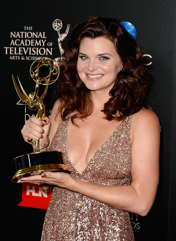 . Actress Heather Tom poses with the Outstanding Lead Actress In A Drama Series award for \'The Bold and the Beautiful\' in the press room during The 40th Annual Daytime Emmy Awards at The Beverly Hilton Hotel on June 16, 2013 in Beverly Hills, California.  (Photo by Mark Davis/Getty Images)