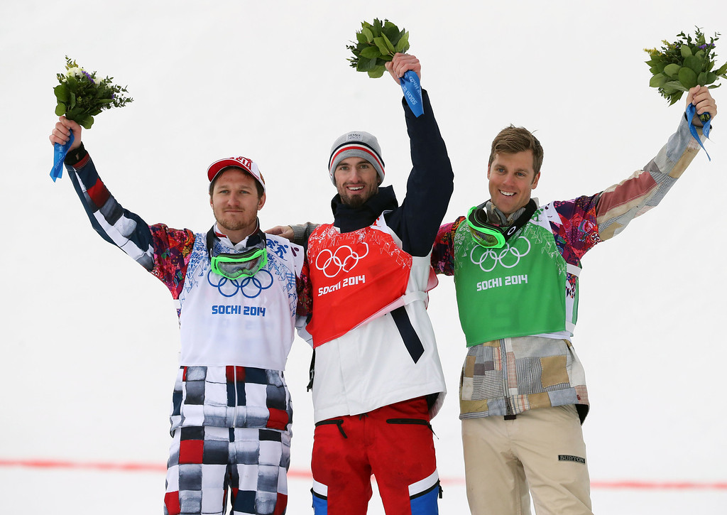 . Pierre Vaultier (C) of France wins the gold medal, Nikolay Olyunin (L) of Russia wins the silver medal and Alex Deibold of the USA wins the bronze medal during the Snowboarding Men\'s Snowboard Cross at the Rosa Khutor Extreme Park on February 18, 2014 in Sochi, Russia. (Photo by Christophe Pallot/Agence Zoom/Getty Images)