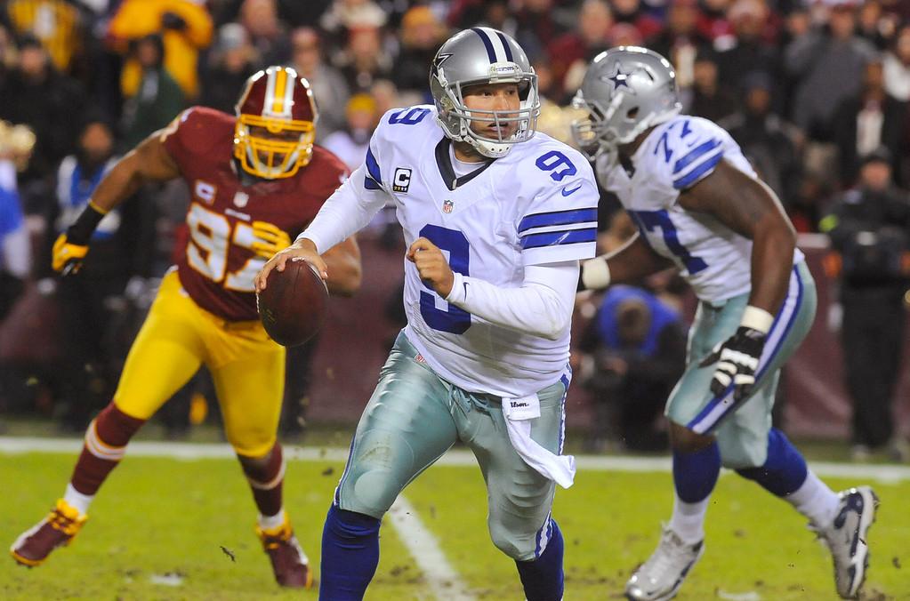 . Dallas Cowboys quarterback Tony Romo (9) scrambles during the first half of an NFL football game against the Washington Redskins on Sunday, Dec. 30, 2012, in Landover, Md. (AP Photo/Richard Lipski)
