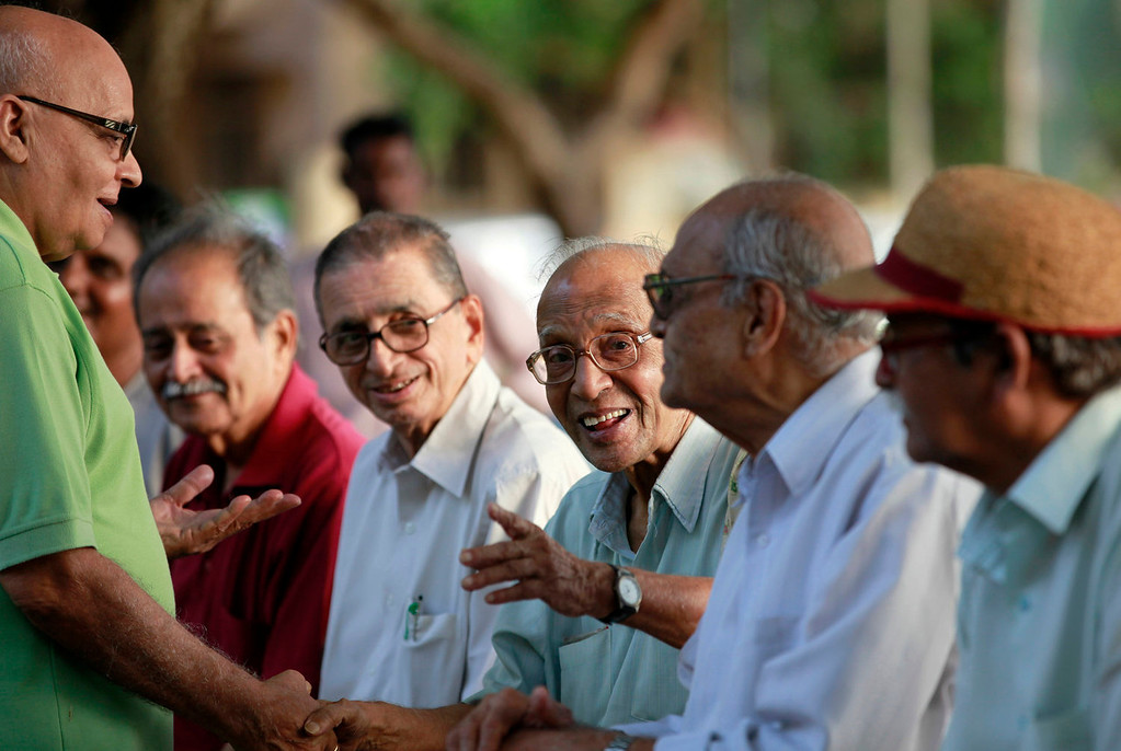 . Elderly Indians talk at a park on International Day of Older Persons in Mumbai, India,Tuesday, Oct. 1, 2013. Much of the world is not prepared to support the ballooning population of elderly people, including many of the fastest-aging countries, according to a global study scheduled to be released Tuesday, Oct. 1, by the United Nations and an elder rights group. (AP Photo/Rajanish Kakade)