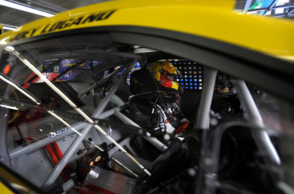 . Joey Logano waits in his car before practice for Saturday\'s NASCAR Sprint Cup series auto race at Charlotte Motor Speedway in Concord, N.C., Friday, Oct. 11, 2013. (AP Photo/Mike McCarn)