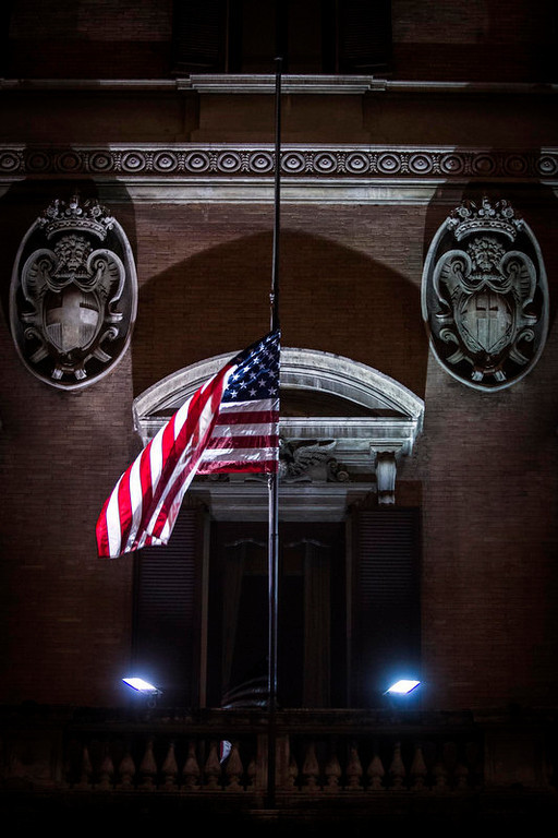 ". The American flag flies at half staff to mourn the victims of the Connecticut school shooting, at the U.S. Embassy in Rome, Saturday, Dec. 15, 2012. Police said Saturday they had found ""very good evidence\"" they hoped would answer questions about the motives of the 20-year-old gunman, described as brilliant but remote, who forced his way into a U.S. school and killed 26 children and adults in one of the world\'s worst mass shootings. (AP Photo/Angelo Carconi)"