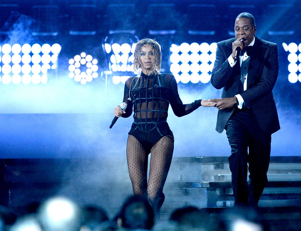 . Singer Beyonce and rapper Jay Z perform onstage during the 56th GRAMMY Awards at Staples Center on January 26, 2014 in Los Angeles, California.  (Photo by Kevork Djansezian/Getty Images)