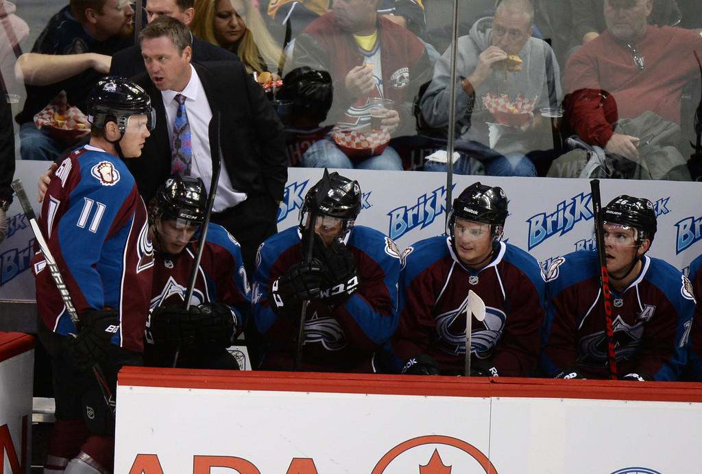 . DENVER, CO - OCTOBER 04 : Head coach Patrick Roy of Colorado Avalanche is talking to Jamie McGinn (11) during the 1st period of the game against Nashville Predators at Pepsi Center. Denver, Colorado. October 4, 2013. (Photo by Hyoung Chang/The Denver Post)