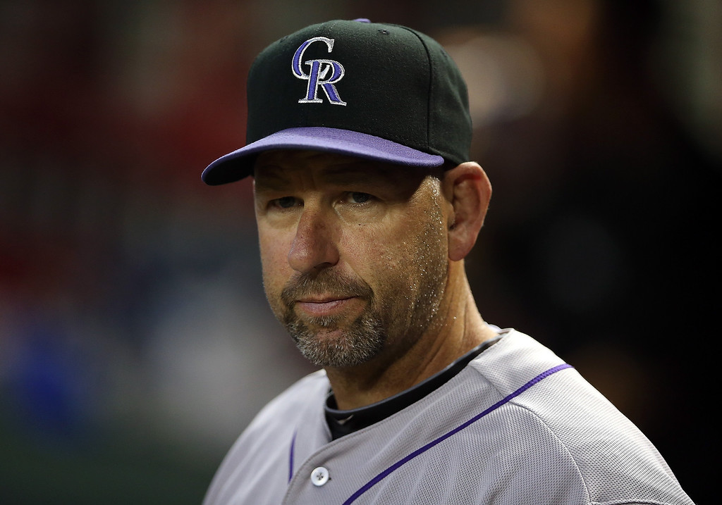 . Manager Walt Weiss #22 of the Colorado Rockies watches from the dugout during the MLB game against the Arizona Diamondbacks at Chase Field on April 29, 2014 in Phoenix, Arizona.  (Photo by Christian Petersen/Getty Images)