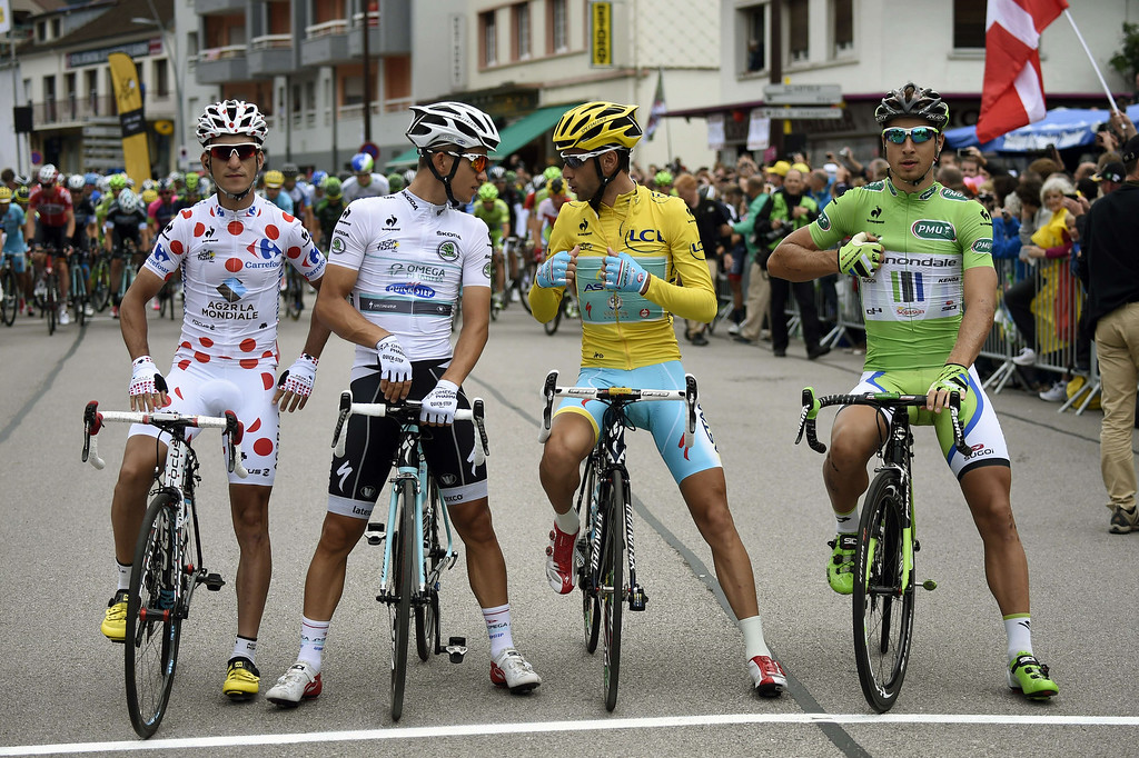 . (From L) France\'s Blel Kadri wearing the best climber\'s polka dot jersey, Poland\'s Michal Kwiatkowski wearing the best young\'s white jersey, Italy\'s Vincenzo Nibali wearing the overall leader\'s yellow jersey and Slovakia\'s Peter Sagan wearing the best sprinter\'s green jersey wait for the start of the 170 km ninth stage of the 101st edition of the Tour de France cycling race on July 13, 2014 between Gerardmer and Mulhouse, eastern France.  AFP PHOTO / ERIC FEFERBERGERIC FEFERBERG/AFP/Getty Images