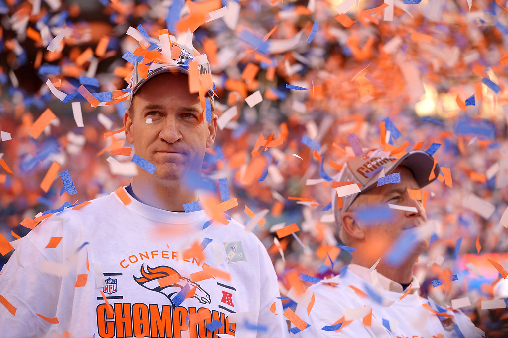 . Denver Broncos quarterback Peyton Manning (18) during the trophy presentations after the Denver Broncos beat the New England Patriots in the AFC Championship game at Sports Authority Field at Mile High in Denver on January 19, 2014. (Photo by John Leyba/The Denver Post)