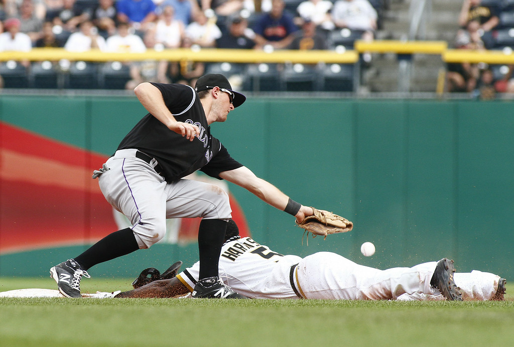 . Josh Harrison #5 of the Pittsburgh Pirates steals second base on Vinny Castilla #9 of the Colorado Rockies in the seventh inning during the game at PNC Park on July 20, 2014 in Pittsburgh, Pennsylvania.  (Photo by Justin K. Aller/Getty Images)