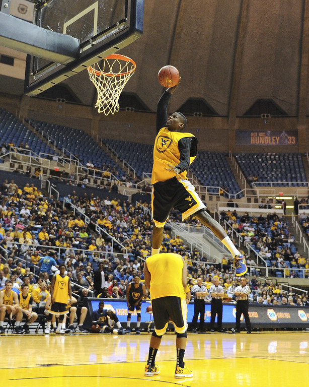 . West Virginia\'s Eron Harris goes to the basket during the slam dunk contest as part of the NCAA college basketball team\'s scrimmage Friday, Oct. 18, 2013, in Morgantown, W.Va. (AP Photo/Andrew Ferguson)