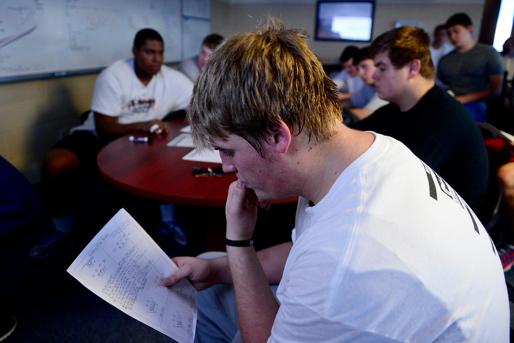 . Valor Christian starting left tackle Alec Ruth looks over his notes during an offensive line meeting.  (Photo by AAron Ontiveroz/The Denver Post)
