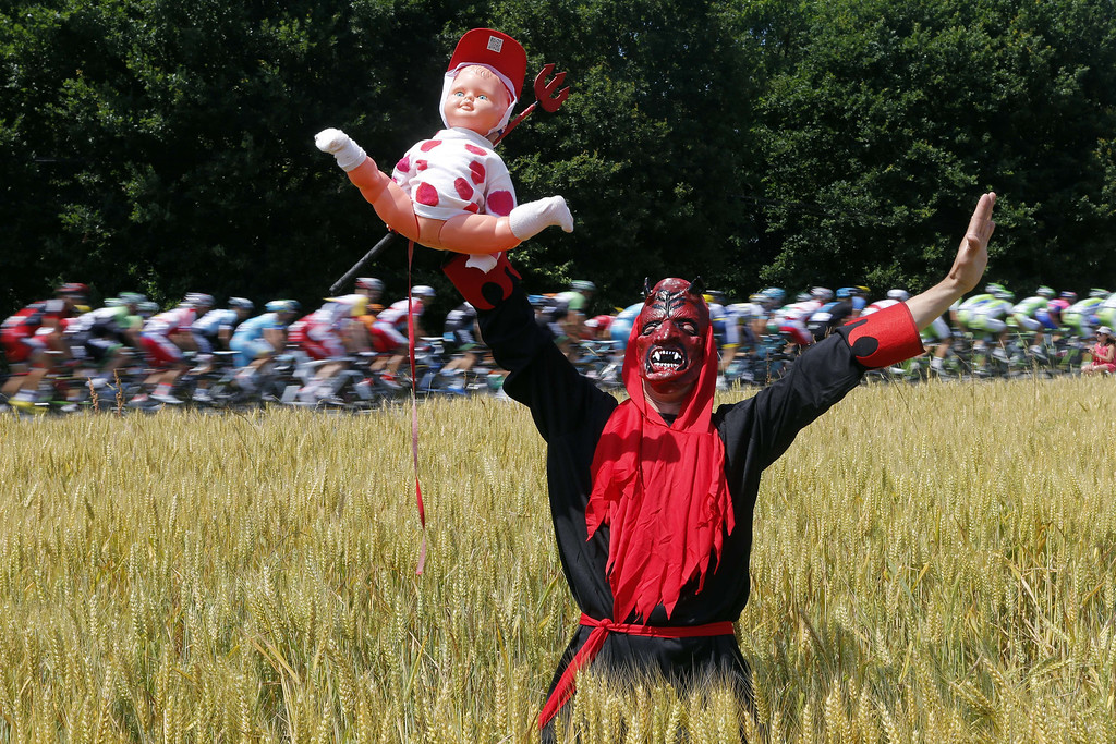 . A supporter disguised as devil is pictured as the pack rides behind during the 197 km tenth stage of the 100th edition of the Tour de France cycling race on July 9, 2013 between Saint-Gildas-des-Bois and Saint-Malo, northwestern France.    JOEL SAGET/AFP/Getty Images
