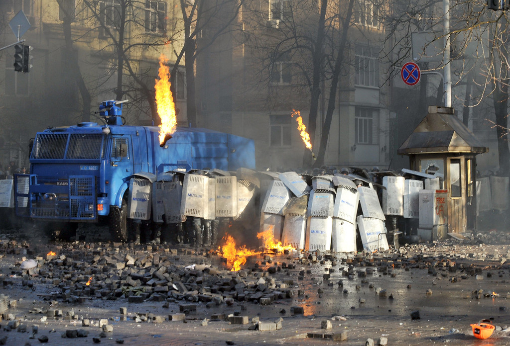 . Anti-government protesters clash with police in in the center of Kiev on February 18, 2014. Police on Tuesday fired rubber bullets at stone-throwing protesters as they demonstrated close to Ukraine\'s parliament in Kiev, an AFP reporter at the scene said. Police also responded with smoke bombs after protesters hurled paving stones at them as they sought to get closer to the heavily-fortified parliament building. AFP PHOTO/GENYA SAVILOV/AFP/Getty Images