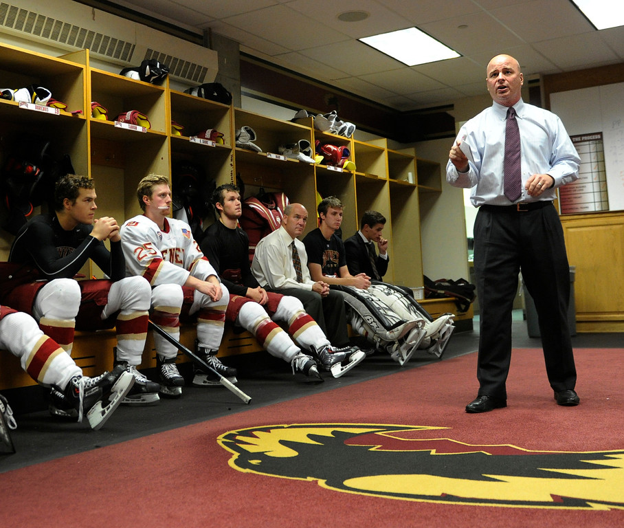 . DENVER, CO. - OCTOBER 12: Denver coach Jim Montgomery talked to the team before the game. The University of Denver hockey team hosted Merrimack at Magness Arena, Saturday night, October 12, 2013. Photo By Karl Gehring/The Denver Post